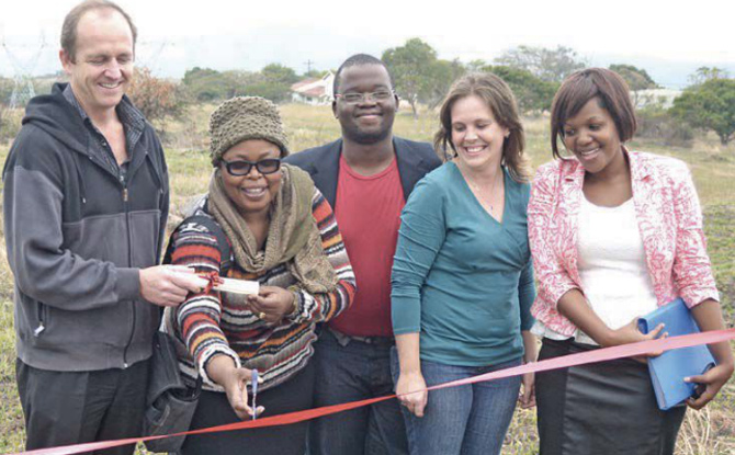 Taurus Packaging managing director Jan Riekert, Abethu Home found Sibongile Ntsetha, Abethu Home manager Malusi Shezi, Mariska Steyn from Baysis Best Properties and Abethu Home secretary Nogukhanya Mthlyane happily unveil Abethu Home's new piece of land donated by Taurus Packaging.